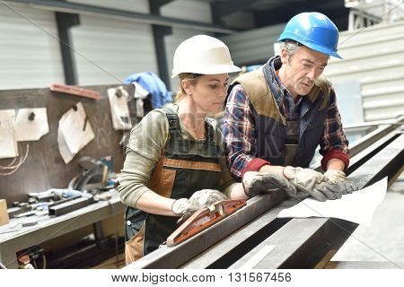 Engineers working in metallurgy warehouse