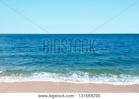 Sandy beach backdrop with turquoise water and blue sky tropical holiday concept