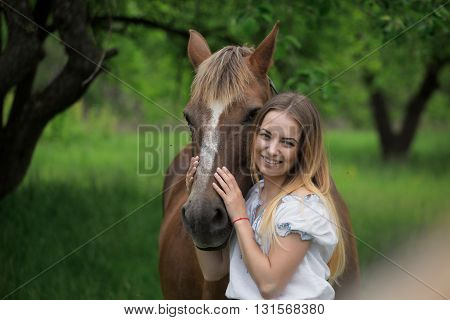Outdoor Portrait Of Young Beautiful Woman With Horse