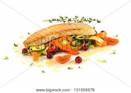 vegetable stew with fish and cranberries on a white background