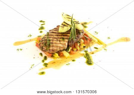 vegetable stew with meat and pesto sauce on white background
