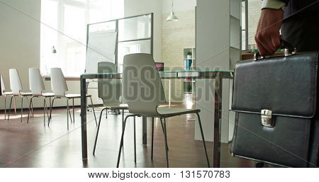 Businessman entering empty board room
