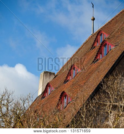 Mansard windows in tiled roof in traditional german style