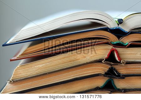 stack of opened old books close-up horizontal backround