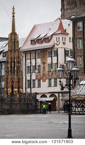 NURENBERG, GERMANY - JANUARY 05, 2012: It's snowing on the Hauptmarkt