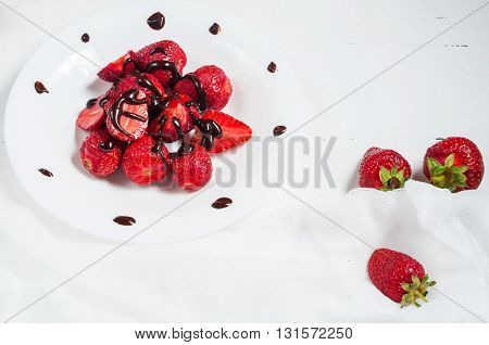Strawberries dipped in delicious chocolate isolated on the white background