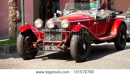 Italy, Sirmione - JUNE 23, 2013: Vintage car Alfa Romeo on the streets of Sirmione