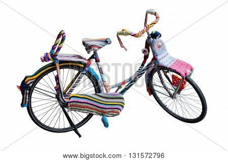 Bike tied with colored wool threads isolated on white