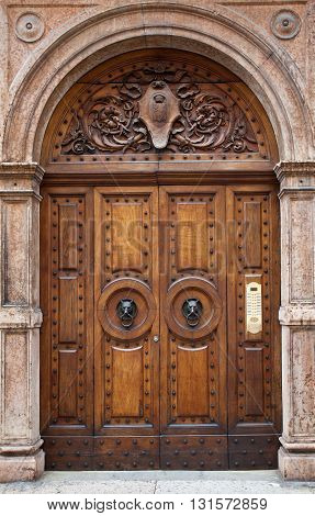 Ancient wooden doors with wolf head knobs