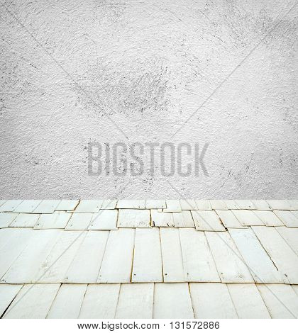 Empty retro room with cement wall and wooden floor