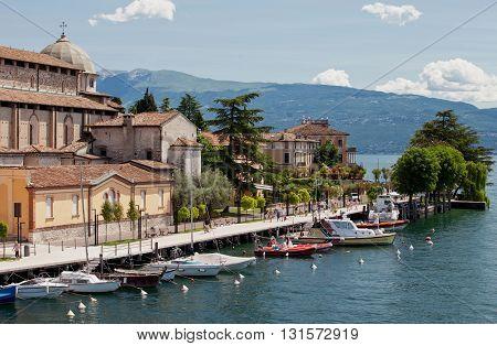 ITALY, SALO - JUNE 26, 2013: Salo town promenade. Garda lake coast. Italy