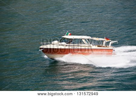 ITALY, GARDA LAKE - JUNE 26, 2013: Speed boat on garda lake