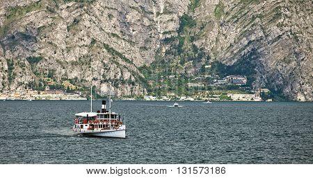 ITALY, MALCESINE - JUNE 26, 2013: Vintage steamer transports people between Malcesine and Limone