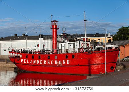 FINLAND, HELSINKI - JUNE 15, 2011: Bright red lighthouse ship Relandersgrund at pier in Helsinki. Today it is a restaurant and night club