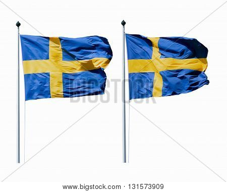 The flags of Sweden waving in the wind on the flagpoles isolated on white