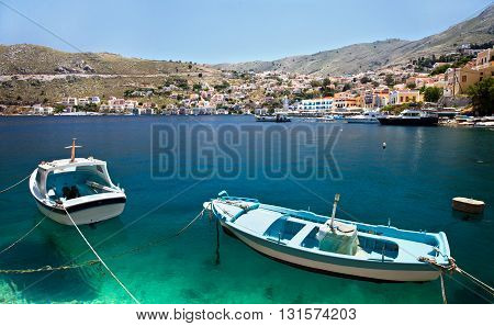 SYMI, GREECE - MAY 15, 2015: Fishing boats in the harbour of Symi