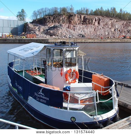TURKU, FINLAND - MAY 12, 2012: Small river ferry Pikkufori at the pier on the Aurajoki river in the Turku city