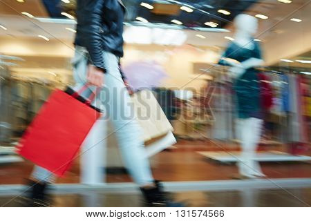 Blurred image of female in shopping mall