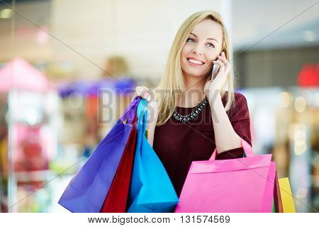 Woman talking on the phone in shopping mall