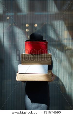 Woman with heap of boxes