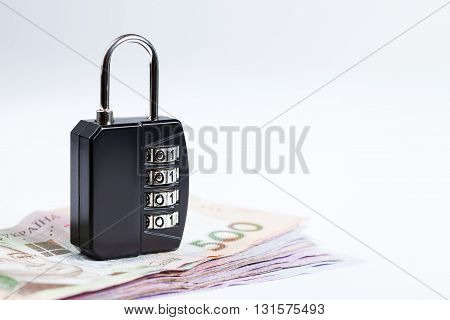 Money safety stability concept image. Lock over ukrainians hryvnias banknotes
