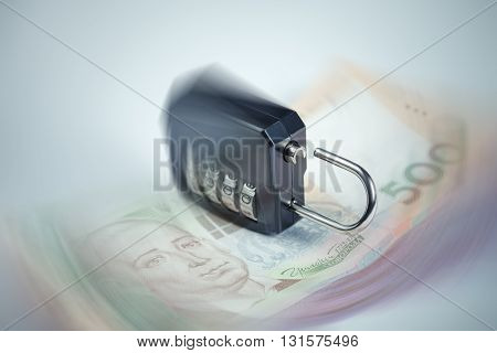 Ukrainian hryvnia fall concept. Ulocked lock as a sign of the beginning of financial chaos