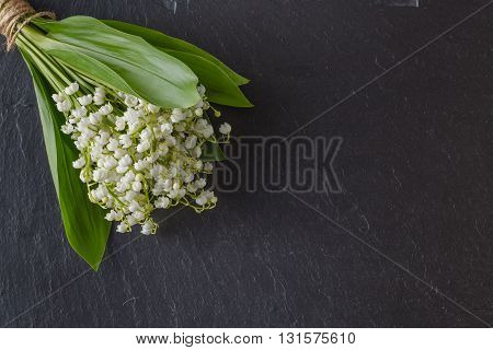 Bouquet Of Lily Of The Valley Flowers On Dark Background, Copy Space, Selective Focus
