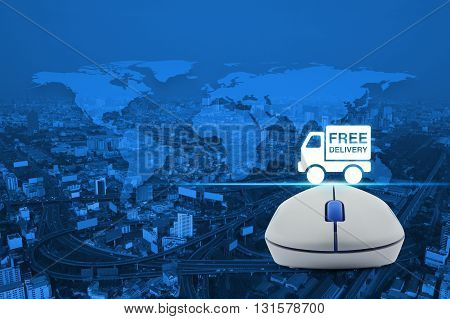 Wireless computer mouse with free delivery truck icon over map and city tower background Transportation business concept Elements of this image furnished by NASA