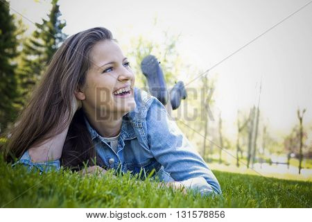young caucasian  brunette wearing summer outfit outdoors