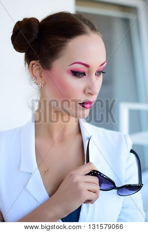 Beautiful girl with bright creative colorful fashion makeup. Art beauty design. Pink eyebrows, two color gradient lips