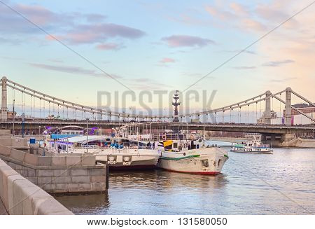 Moscow, Russia - April 18, 2015: Crimean bridge in Moscow spring evening and ships on water
