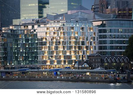 LONDON, UK - SEPTEMBER 19, 2015: City of London office buildings at sunset and first night lights