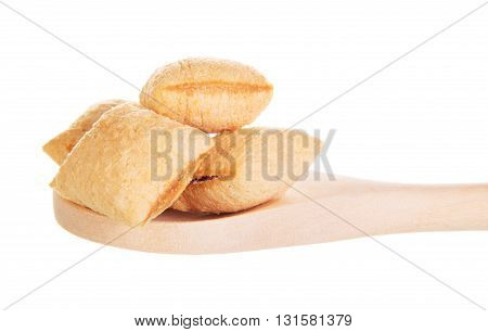 Dry breakfast of crunchy  with cocoa stuffing in a wooden spoon isolated on white background.