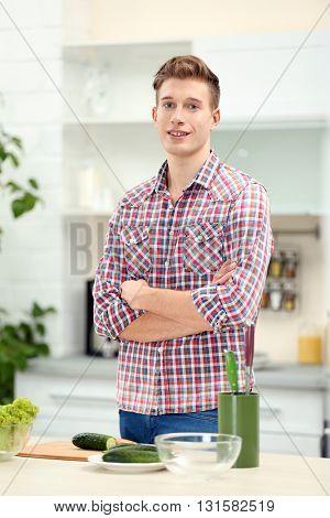 Happy handsome man in bright kitchen