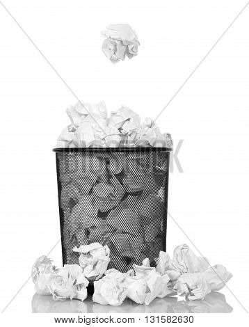 Metallic black trash from a paper isolated on white background.