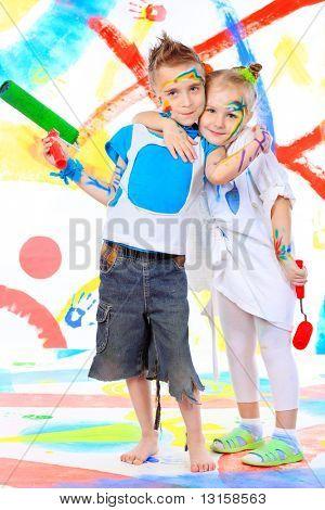 Two beautiful children enjoying their painting. Education.