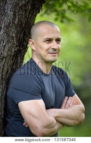 Closeup of an European man outdoor with arms folded