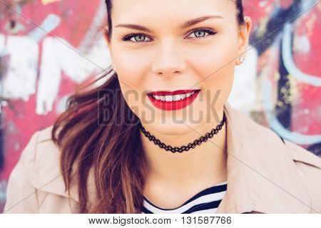 Portrait Of Young Attractive Brunette On A Bright Background