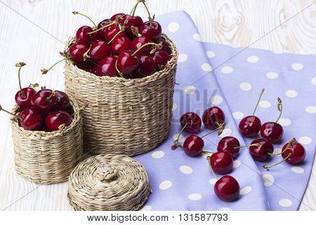 Cherry baskets on the white wooden desk