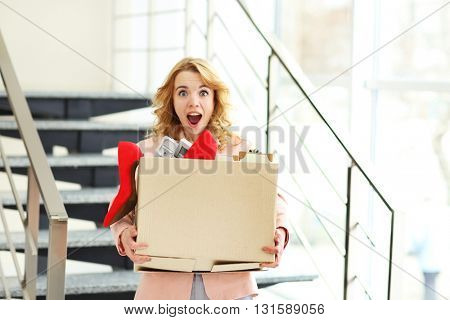 Businesswoman with moving box in office