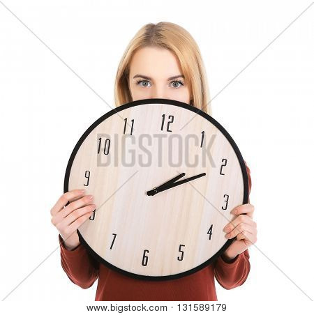 Beautiful young girl holding clock, isolated on white