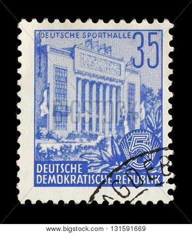 ZAGREB, CROATIA - SEPTEMBER 05: A stamp printed in GDR, shows sports hall, series Five-year plan, circa 1953, on September 05, 2014, Zagreb, Croatia