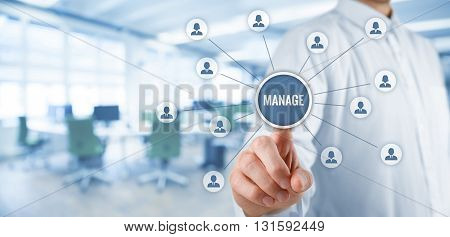 Manager click on button with text manage. Managerial business concept. Wide banner composition with office in background.