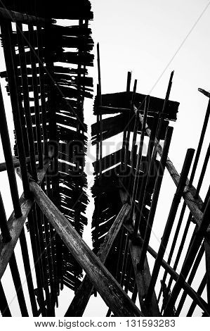 Traditional wooden construction in Basha Guizhou China. Black and white abstract worm's eye view