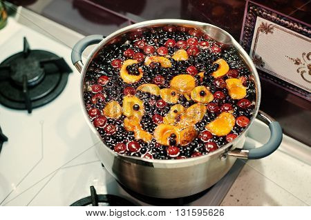 Production Of Cranberry, Currant And Apricot Compote On Pot At Kitchen