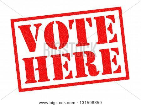 VOTE HERE red Rubber Stamp over a white background.