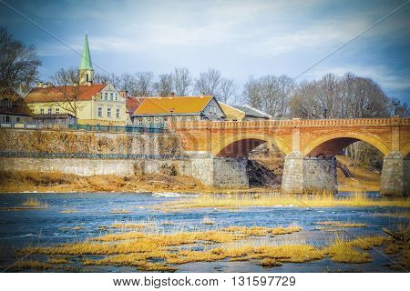 River,Church and old red stone bridge in autumn day