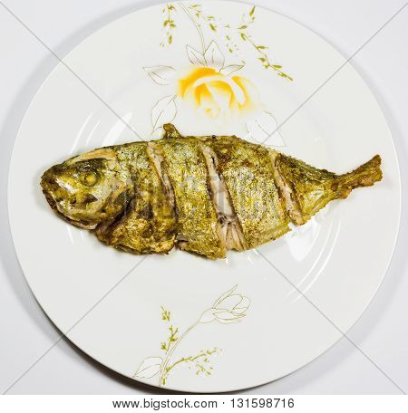 Oil fried fish on the plate, fish is ready for eating