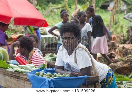 Seghe, Solomon Islands - June 16, 2015: Woman selling betel nut at the local market in the village of Seghe.