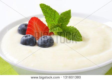bowl of semolina pudding with fresh fruit - detail
